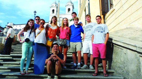 Students from the ISA High School program in Italy pose for a group photo on the Spanish Steps.